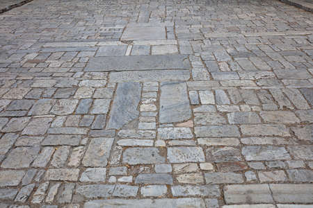 Marble stone paved street, texture background, high angle view. Athens, Greece. Cobblestone pathway to Acropolis, Athens Greece, perspective view