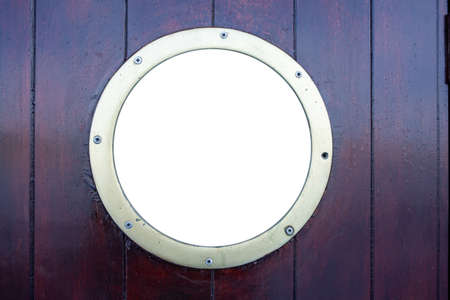 Ship porthole on brown wooden wall background. Round boat scuttle, empty blank white glass, mockup, template, copy space