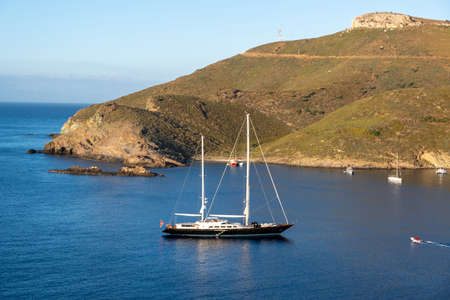 Sailing Boat, yacht moored on blue calm sea around Kea,Tzia island in Greece. Summer holidays in Aegean Mediterranean sea, Otzias under clear sky background.