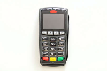 POS terminal isolated on white background, top view.Terminal cash register machine for contactless payment with credit card. Banking equipment, NFC.