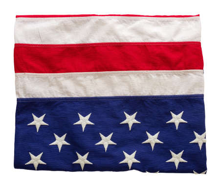 USA flag folded isolated cutout on white background. American flag top view. Memorial day and 4th of July, Independence day concept