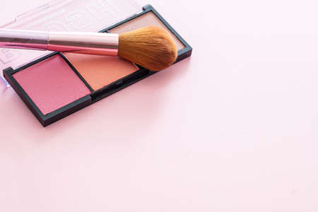Blush powder pallete set pastel colors and brush against pink background, closeup view. Professional tools for make up, beauty salon, cosmetics concept