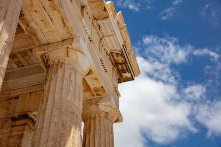Athens Acropolis, Greece landmark. Ancient Greek Propylaea entrance gate part of ceiling and pillars low angle view, blue sky, spring sunny day.