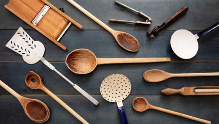 Cooking concept. Vintage kitchen utensils, empty culinary equipment flat lay on blue wooden table background, top view