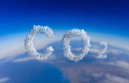 CO2 carbon dioxide pollution sign. Emissions smog cloud symbol on blue sky background. Planet climate change, global warming concept. 3d illustration 免版税图像