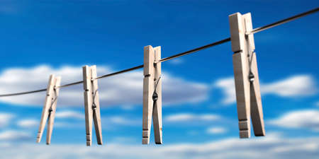 Clothespins on clothes cord against blur blue sky background. Laundy drying retro tools, pegs for clothes hanging. 3d illustration