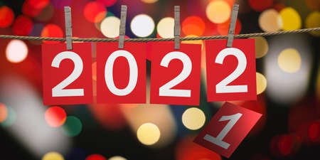 2022 New Year Celebration on rope with clothespins. Digits on red paper cards against festive bokeh background. 3d illustration