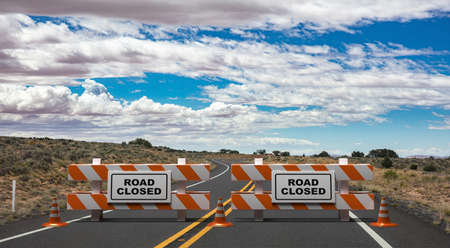 Closed road text sign, street barriers and traffic cones on empty highway, cloudy blue sky and USA countryside background. Construction safety, roadwork in progress. 3d illustration