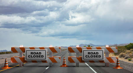 Closed road text sign, street barriers and traffic cones on empty highway, cloudy sky and USA countryside background. Construction safety, roadwork in progress. 3d illustration