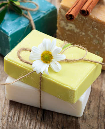 Homemade chamomile soaps. White and yellow color handmade soap bars closeup view. Natural healthy herbal cosmetics