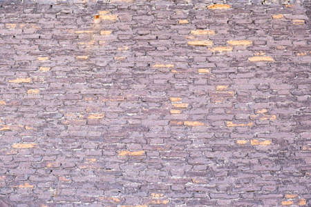 Old brown red color brick wall background and texture, closeup view. Exterior building weathered facade detail 写真素材