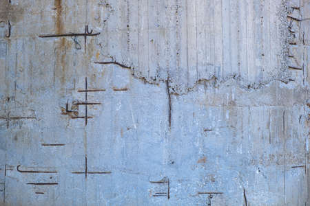 Reinforced concrete with damaged and rusty steel reinforcement. Old distressed wall texture background, steel bars and mesh visible corrosion 写真素材