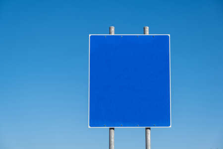 Blank road sign on two metal poles, clear blue sky background. Information sign template, copy space Imagens