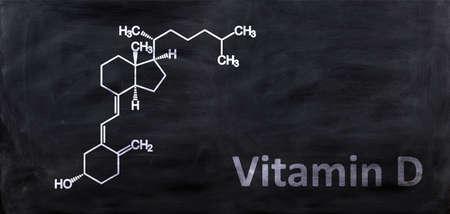 Vitamin D D3 structural chemical formula, drawing on a chalk black board, School chemistry class. Cholecalciferol, colecalciferol, C27H44O molecule.