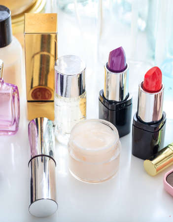 Makeup cosmetics on white background. Cosmetology industry creates luxury collection for skincare, fashion, beauty and protection of women face. Vertical, closeup view.
