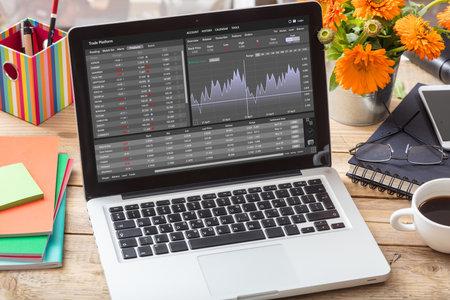 Trade platform, forex trading. Stock exchange market analysis, monitoring app on laptop screen, office desk background. Binary option, candlestick chart. Archivio Fotografico