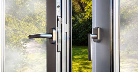 Aluminum window open detail. Metal, PVC door frame closeup view. Energy efficient, safety profile, gaarden background outdoor Foto de archivo