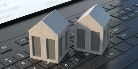 Modern model houses on laptop keyboard background. Technology and home concept. Close up of miniature real-estate on computer keypad, online search, buy rent property mortgage. Banner. 3d illustration Reklamní fotografie
