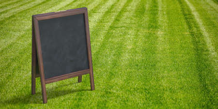 Chalkboard at nature in summer concept. Wooden frame blackboard blank for advertise. Outdoors standing billboard, promotion, green grass arena background. Copy space, banner, template. 3d illustration Reklamní fotografie