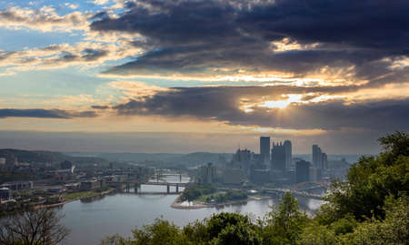 Pittsburgh Pennsylvania US of America, Pittsburgh city downtown aerial view from Point of view park, cloudy sky at sunset Reklamní fotografie
