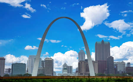 St. Louis, Missouri, USA. Saint Louis city downtown cityscape and Getaway arch, blue cloudy sky background