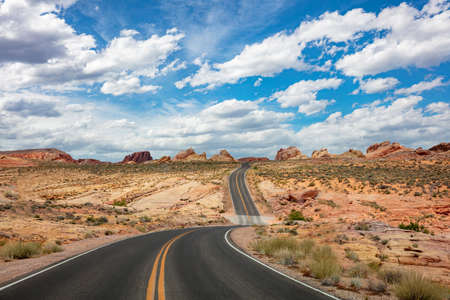 Valley of Fire State park, Nevada, USA, Empty scenic asphalt winding road in a sunny spring day, Blue cloudy sky background Reklamní fotografie