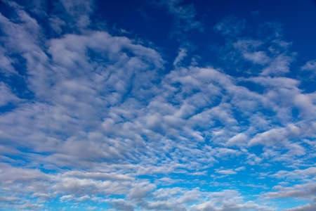 Cloudscape on blue sky background. Fluffy clouds white and grey color, Abstract texture.