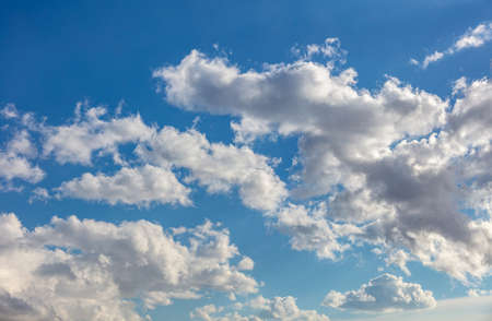 Cloudscape on blue sky background. Fluffy cumulus clouds white and grey color, Abstract texture. Reklamní fotografie