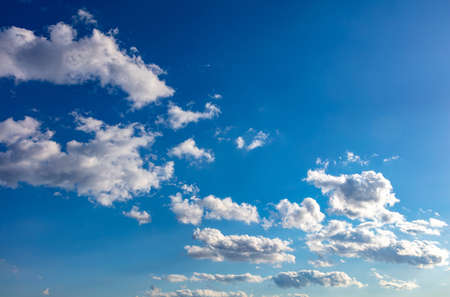 Fluffy cumulus clouds white and grey color, Cloudscape on blue sky background. Abstract texture.