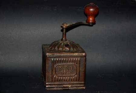 Italy : Vintage coffee grinder with wood manual hand crank.