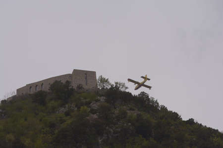 Plane engaged in mountain firefighting operation in Southern Italy,April 19,2020. Editoriali