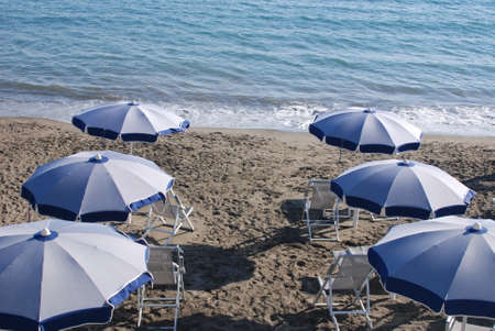 Italy : Empty Chairs And Umbrellas On Beach,June 28,2020.