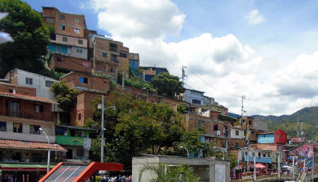 houses stacked in the favela comune thirteen in medellin