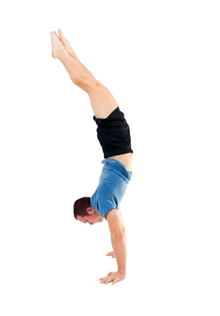 hang body: man dooing a handstand