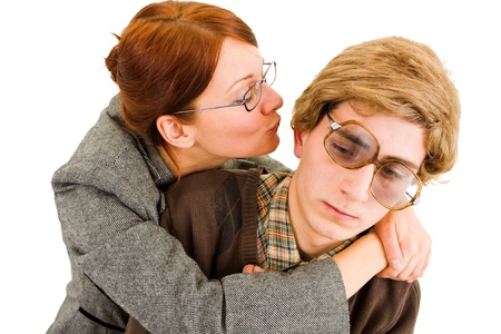 dweeb: woman trying to kiss a nerd  Stock Photo
