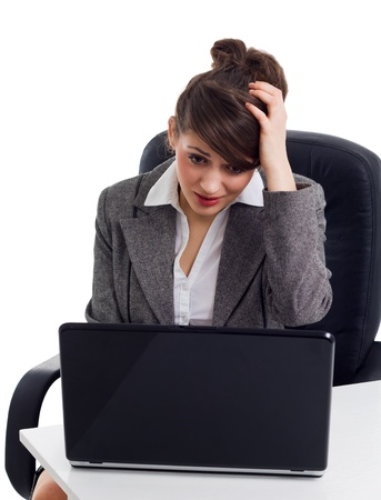 shocked business woman in front of laptop  photo