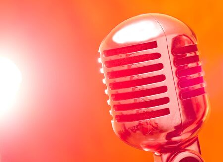 vintage microphone on stage with strobe lights
