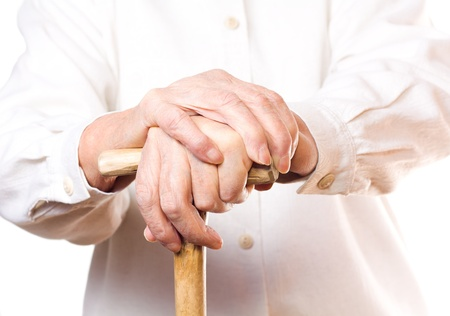 hand of an old man in white, with isolated background photo
