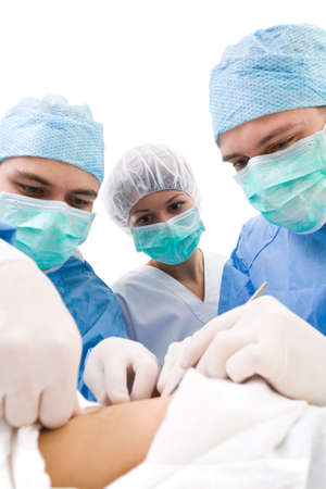 surgeons with patient on operation table during their work  photo