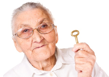 congenial: Old woman with isolated background, holding key