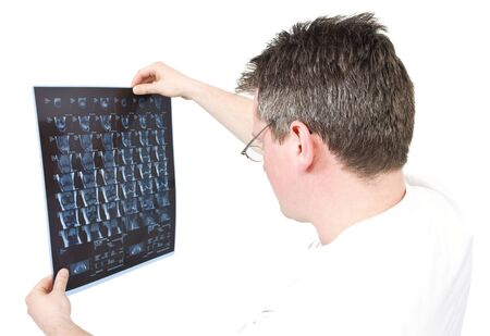 Doctor viewing MRI scans with isolated background photo