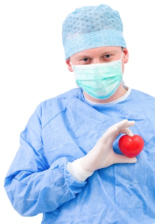 Young doctor with heart in his hand photo