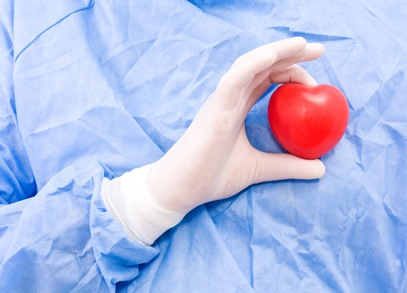 Young doctor with heart in his hand Stock Photo - 10012134