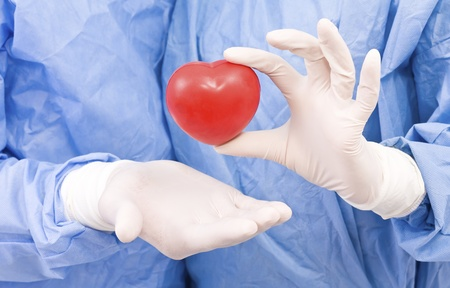 Young doctor with heart in his hand Stock Photo