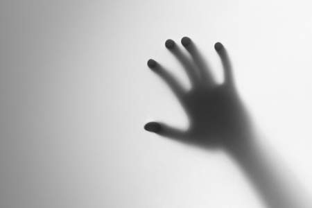 Silhouette of a hand, blur photo
