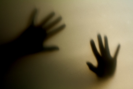 abnormal: Silhouette of a hand, blur