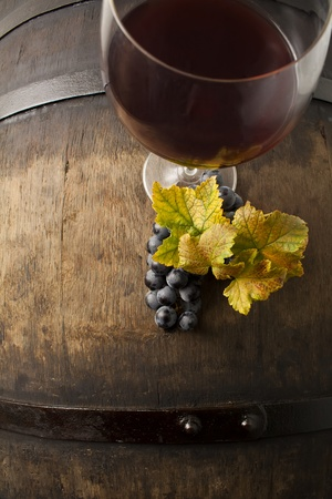 Red Wine on barrel with grapes