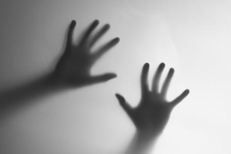creepy hand: Silhouette of a hand, blur