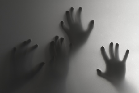 ghostly: Silhouette of a hand, blur