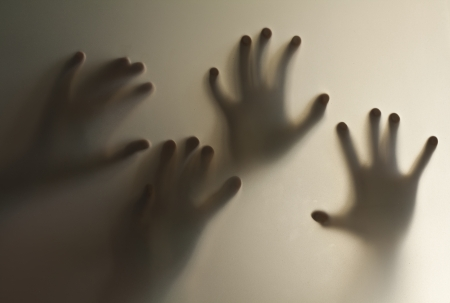 eerie: Silhouette of a hand, blur